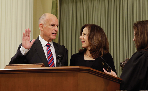 Governor Brown takes the oath of office with First Lady Anne Gust Brown  at his side and Chief Justice Tani Cantil-Sakauye officiating. Associated Press Photo