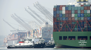 Trade observers predict reducing the backlog of containers on the West Coast docks will take many weeks.