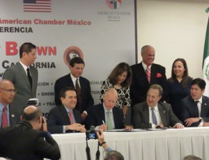 At the signing of a pact to strengthen trade and investment cooperation are (seated from left) Assemblymember Chris Holden (D-Pasadena), Mexico Secretary of Economy Ildefonso Guajardo Villarreal, Governor Brown, U.S. Ambassador to Mexico E. Anthony Wayne, Senator Kevin de León. Onlookers include: Brian Peck, Governor's Office of Business and Economic Development; First Lady Anne Gust Brown; Mike Rossi, senior advisor to Governor Brown; Panorea Avdis, GO-Biz. Photo by Sara Espinosa.