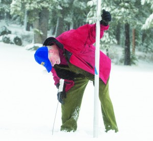 Frank Gehrke of the Department of Water Resources checks the snowpack depth near Echo Summit. The latest survey on December 30, 2015 showed the snowpack was 136% of normal for this time of year. Photo: California Department of Water Resources