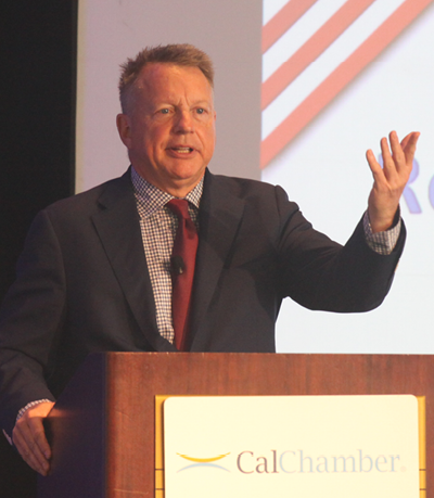 Robert Green of Penn, Schoen & Berland Associates presents highlights of the CalChamber annual survey on California voter attitudes at the opening session of the CalChamber Public Affairs Conference.