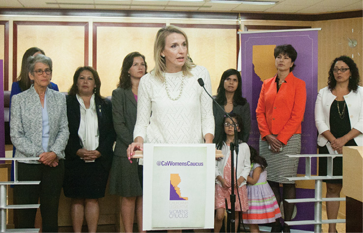 CalChamber Policy Advocate Jennifer Barrera explains CalChamber support for the gender equity pay bill, SB 358 by Senator Hannah-Beth Jackson (D-Santa Barbara; standing at left), at a State Capitol news conference.