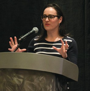 Lisa Kennedy Montgomery entertains attendees during the conference lunch break, using humorous highlights and anecdotes about her career as a radio and TV personality.