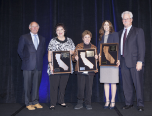 Allan Zaremberg (left) and Mike Murphy (right) recognize (left to right) Yolanda Carrillo, Lucille Harris and Lydia Zabrycki as the Small Business Advocates of the Year.