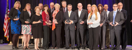 Representatives from 16 of the 28 President's Circle chambers receive their awards at the CalChamber Capitol Summit on May 27. Photo by Steve Yeater