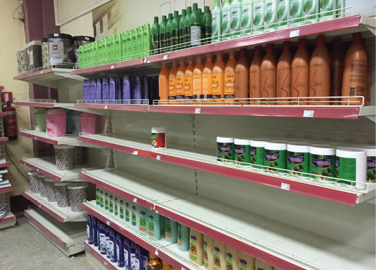 Photo of empty shelves in a state-run grocery store give an idea about supply shortages.